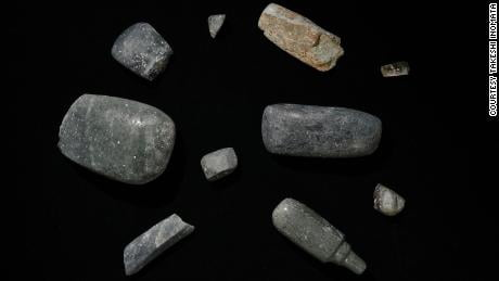 Axes excavated from the site, which date back to 1,000-700 BC. Other precious objects were also found.
